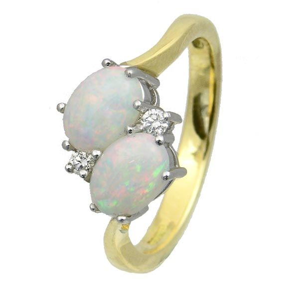 18ct yellow gold opal & diamond crossover ring £1,010 Thorntons Jewellers Kettering