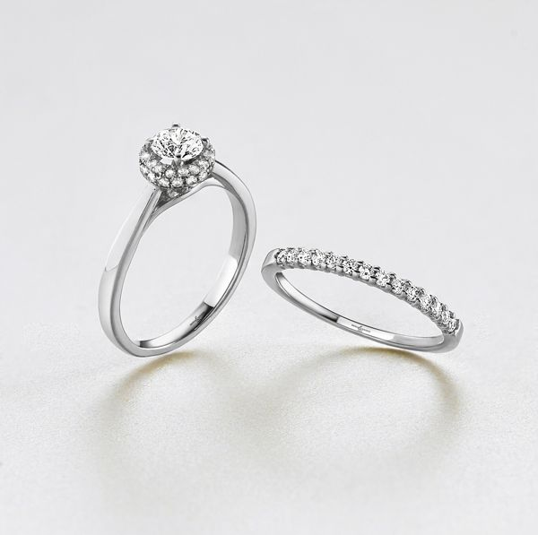 Matching diamond set wedding and engagement rings from AA Thornton Jeweller Kettering Northampton