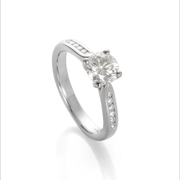 Platinum single stone diamond ring with diamond set shoulders from Thorntons jewellers Kettering Northampton