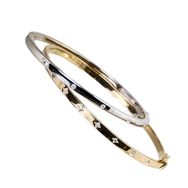 9ct diamond set bangles white gold £750 ref 97150 & yellow gold £1,095 ref 96722 from thornton jeweller diamond jewellery collection in Kettering Northampton