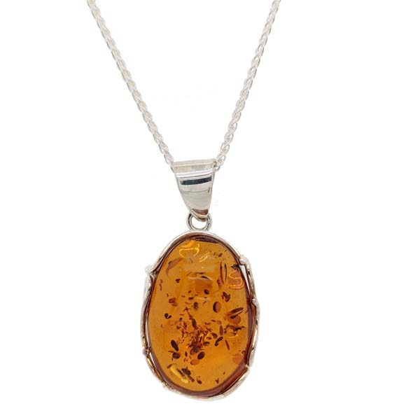 Sally Thorntons Jewellery blog on Amber from AA Thornton Jeweller Kettering Northampton Oval silver scalloped amber pendant on chain £93 our ref 100539