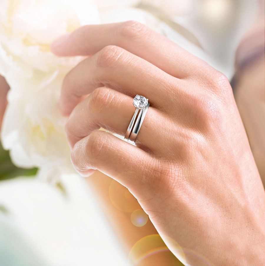 Single stone diamond engagement ring and plain wedding band from Sally Thornton jewellery blog on Wedding Rings at Thorntons Jewellers Kettering Northampton